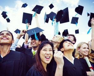 graduation caps in air